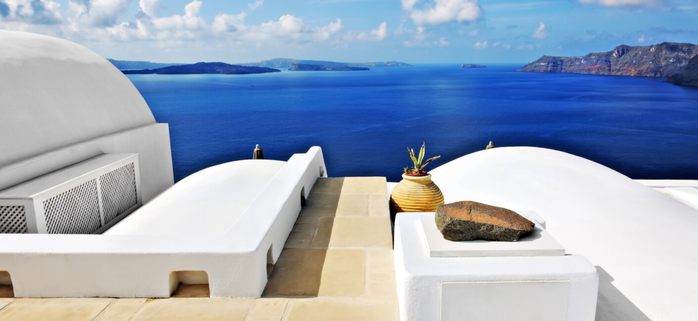 A Cyclades luxury yacht charter allows you to visit some of the most iconic Greek isles, including Delos, Mykonos and Santorini, with it's famed white-washed buildings with stunning blue roofs